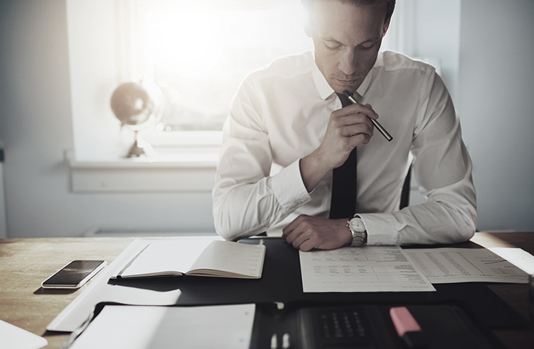 Man Contemplating Business Finances | Elevator Agency