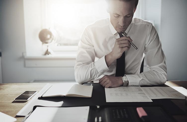 Man Contemplating Business Finances | Elevator Agency